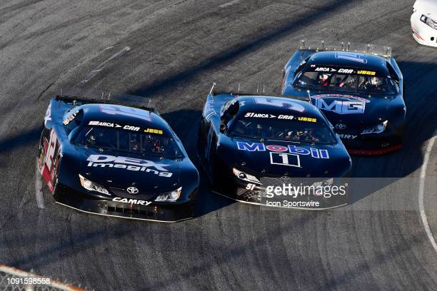Harrison Burton Toyota Camry races Kyle Rowdy Busch KBR Toyota Camry ahead of Connor Okrzesik Toyota Camry and Bubba Pollard Ford Fusion during the...