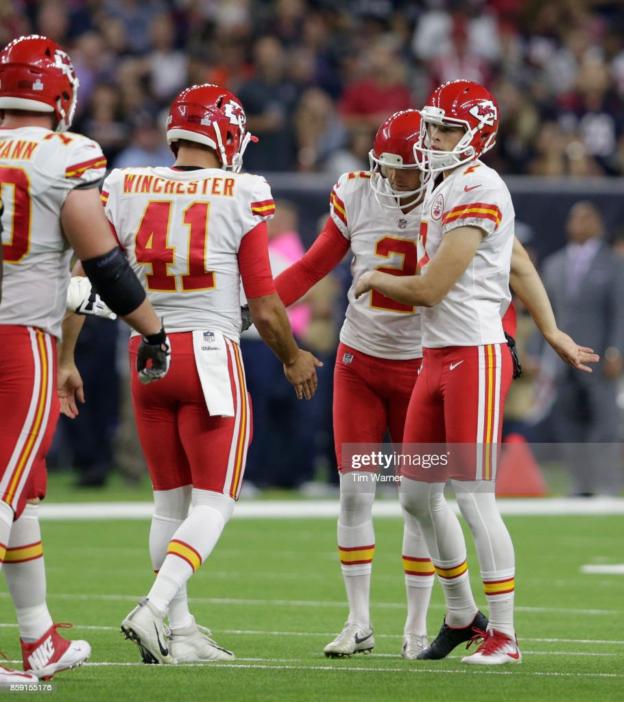 Harrison Butker #7 of the Kansas City Chiefs celebrates a field goal with his teammates in the secound quarter against the Houston Texans at NRG Stadium on October 8, 2017 in Houston, Texas.