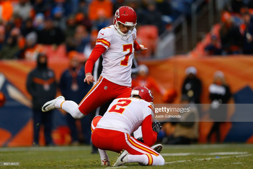 Harrison Butker #7 of the Kansas City Chiefs kicks a third-quarter field goal on a hold from Dustin Colquitt #2 against the Denver Broncos at Sports Authority Field at Mile High on December 31, 2017 in Denver, Colorado. The Chiefs defeated the Broncos 27-24.