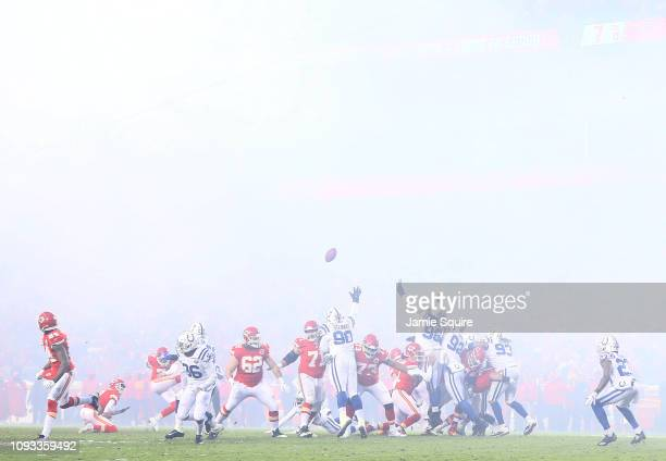 Harrison Butker of the Kansas City Chiefs kicks an extra point during the AFC Divisional round playoff game against the Indianapolis Colts at...