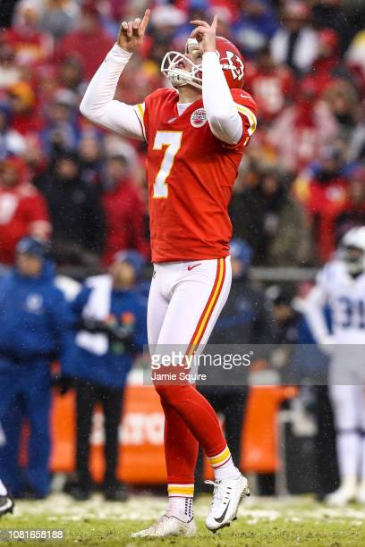 Harrison Butker of the Kansas City Chiefs points to the sky after a successful point after attempt against the Indianapolis Colts during the first...