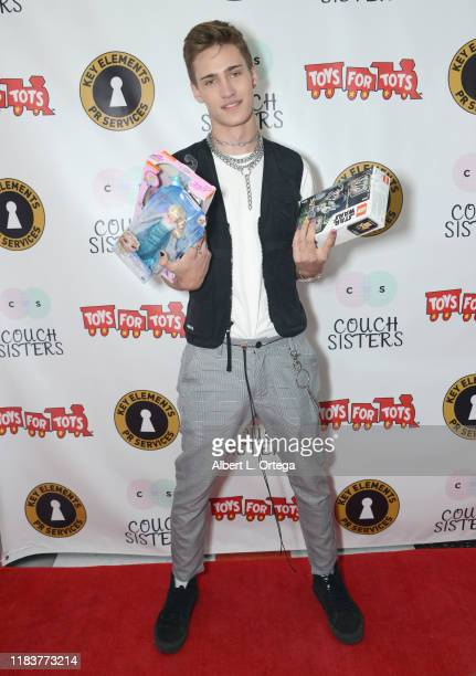 Harrison Cone attends The Couch Sisters 1st Annual Toys For Tots Toy Drive held onNovember 20 2019 in Glendale California