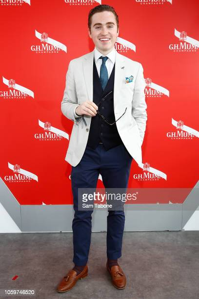 Harrison Craig poses at the Mumm Marquee on Stakes Day at Flemington Racecourse on November 10 2018 in Melbourne Australia