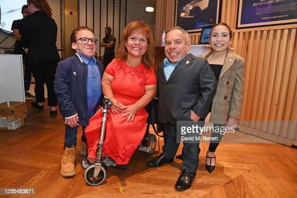 """Harrison Davis, Samantha Davis, Warwick Davis and Annabelle Davis attend the red carpet premiere of new animated children's series """"Moley"""" at Odeon..."""