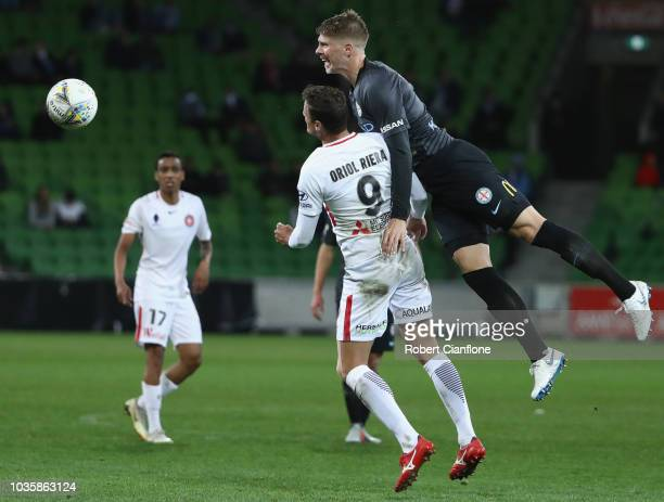 Harrison Delbridge of the Melbourne City compete for the ball with Oriol Riera Magem of the Wanderers during the FFA Cup quarterfinal match between...