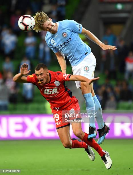 Harrison Delbridge of the Melbourne City heads the ball over Jordy Thomassen of Adelaide United during the round 18 ALeague match between Melbourne...
