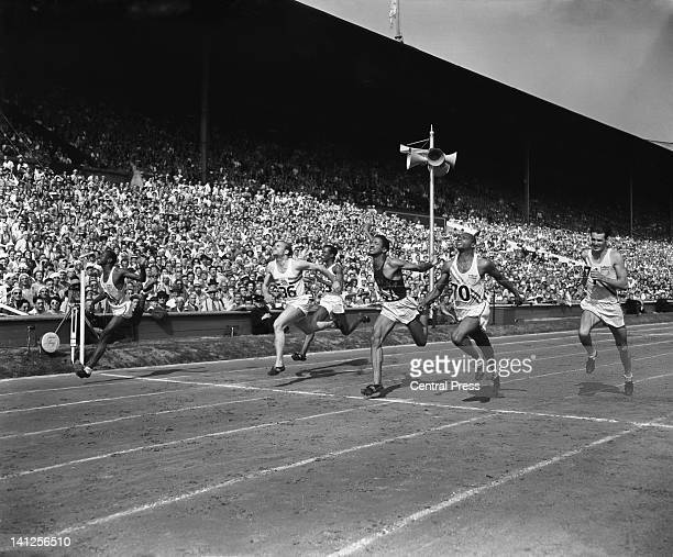 Harrison Dillard of the USA winning the final of the Men's 100 metres event at Wembley Stadium during the London Olympics 31st July 1948 Second is...