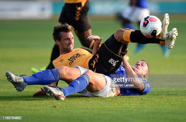 Harrison Dunk of Cambridge United battles for possession with Jonny Evans of Leicester City during the PreSeason Friendly match between Cambridge...