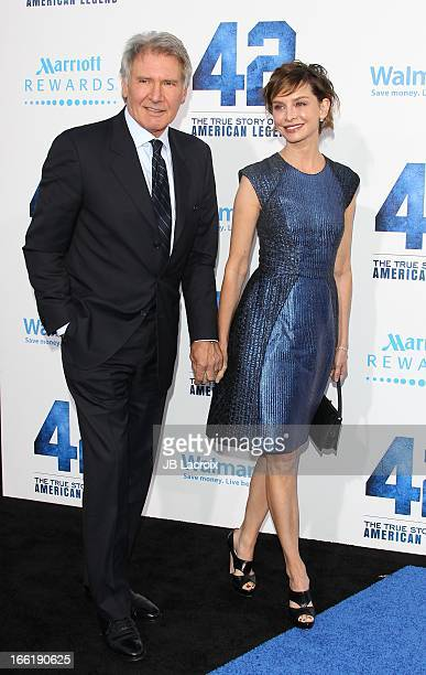 Harrison Ford and Calista Flockhart attend the '42' Los Angeles premiere at TCL Chinese Theatre on April 9 2013 in Hollywood California