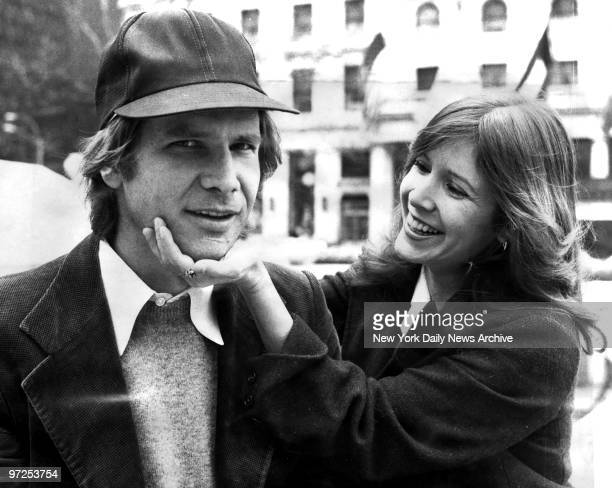 Harrison Ford and Carrie Fisher on Fifth Ave outside The Plaza hotel They were in town for the movie 'Star Wars'