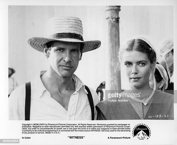 Harrison Ford and Kelly McGillis look on in a scene from the Paramount Pictures movie Witness circa 1985
