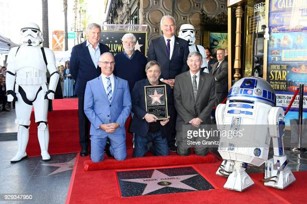 Harrison Ford George Lucas Mark Hamill and Hollywood Chamber of Commerce President/CEO Leron Gubler and guests attend as Mark Hamill is honored with...