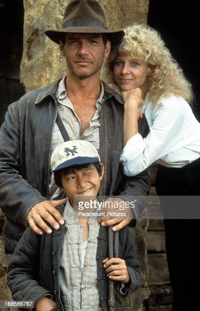 Harrison Ford Jonathan Ke Quan and Kate Capshaw on set of the film 'Indiana Jones And The Temple Of Doom' 1984