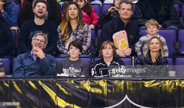Harrison Ford Liam Flockhart and Calista Flockhart attend a hockey game between the Carolina Hurricanes and the Los Angeles Kings at Staples Center...