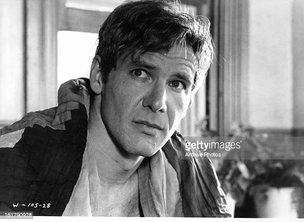 Harrison Ford looking to his right in a scene from the film 'Witness' 1985