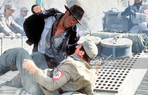 Harrison Ford punches a man in a scene from the film 'Indiana Jones And The Last Crusade', 1989.