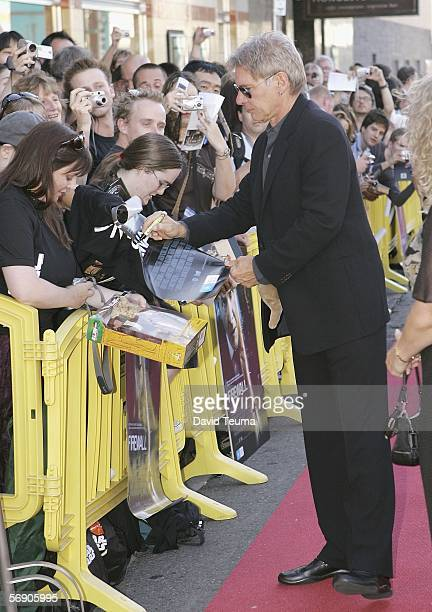 Harrison Ford signs autographs on the red carpet during the premiere of 'Firewall' at Rivoli Cinemas on February 22 2006 in Melbourne Australia