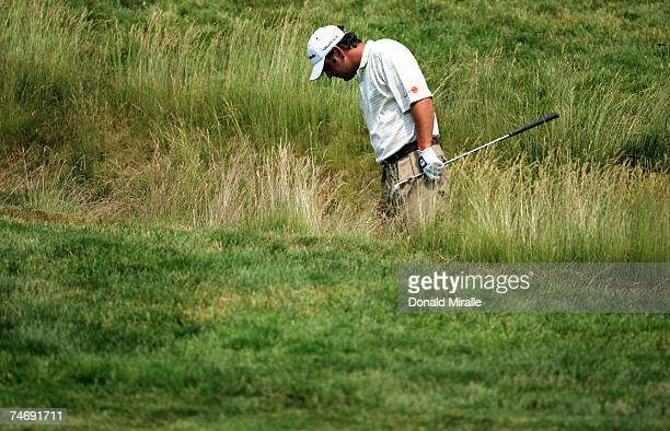 Harrison Frazar hits out of the rough on the eighth hole during the final round of the 107th US Open Championship at Oakmont Country Club on June 17...