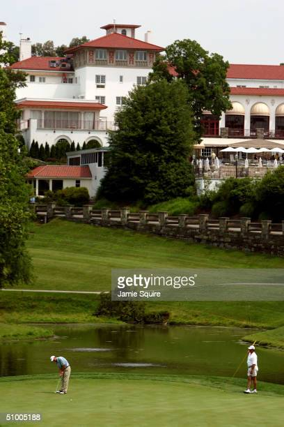 Harrison Frazier putts on the 17th green during the British Open Championship Final Qualifying on June 26 2004 at Congressional Country Club in...