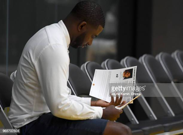 Harrison Gaines agent for Lonzo Ball of the Los Angeles Lakers looks over the bio of LiAngelo Ball during the NBA PreDraft Workout with the Los...