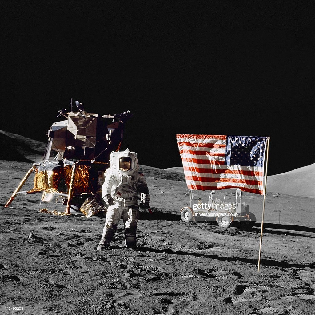 Harrison H Schmitt, pilot of the lunar module, stands on the lunar surface near the United States flag during NASA's final lunar landing mission in the Apollo series 13 December 1972. Credit: NASA. Science Astronaut Space Travel... : News Photo