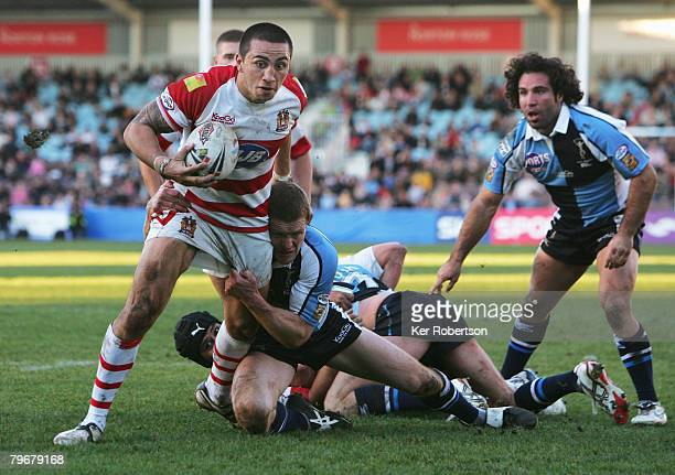 Harrison Hansen of Wigan Warriors holds off the challenge of Matt Gafa of Harlequins RL to score a try for his side during the engage Super League...