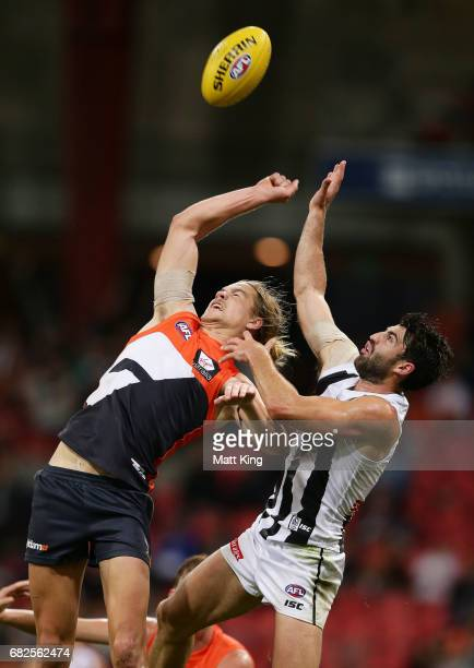 Harrison Himmelberg of the Giants is challenged by Alex Fasolo of the Magpies during the round eight AFL match between the Greater Western Sydney...