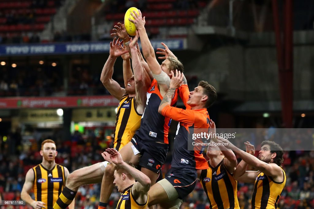 Harrison Himmelberg of the Giants marks during the round 15 AFL match between the Greater Western Sydney Giants and the Hawthorn Hawks at Spotless Stadium on June 30, 2018 in Sydney, Australia.