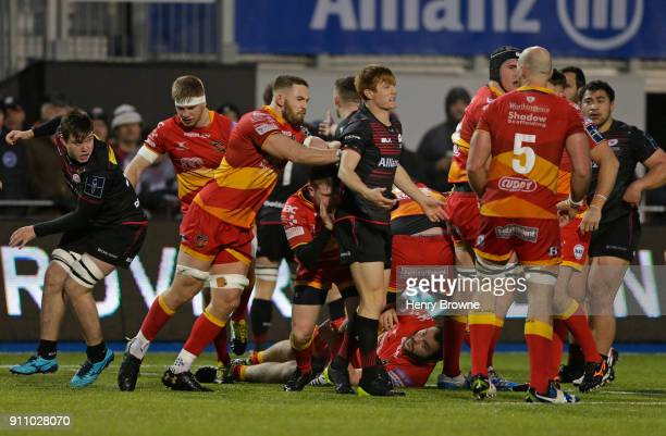 Harrison Keddie of Dragons pushes Nic Stirzaker of Saracens during the AngloWelsh Cup match between Saracens and Dragons at Allianz Park on January...