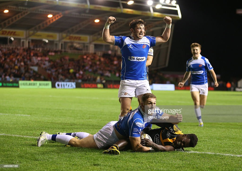 Harrison Keddie of Newport Gwent Dragons celebrates after he scores the match winning try in the final against Wasps during the Singha Premiership Rugby 7's Series finals at Twickenham Stoop on August 28, 2015 in London, England.