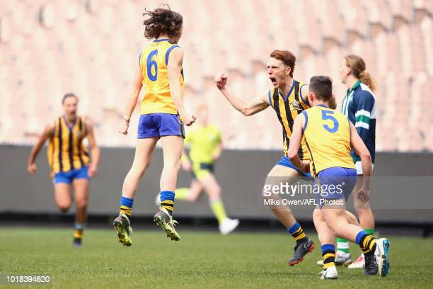 Harrison Kennedy of St Bernard's College celebrates after kicking a goal during the Herald Sun Shield Senior Boys Division 1 Grand Final between St...