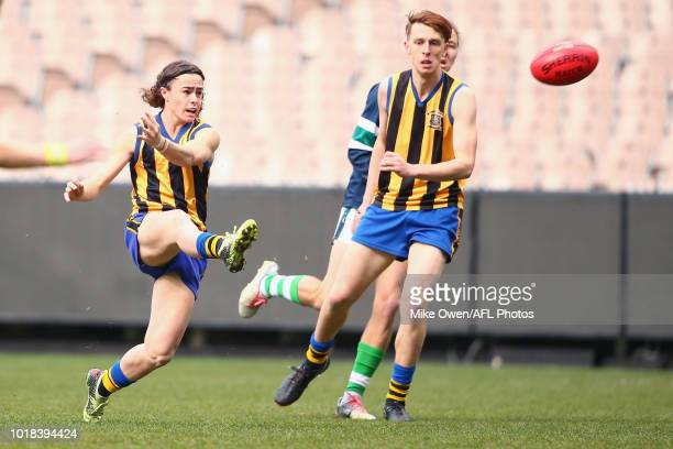 Harrison Kennedy of St Bernard's College kicks a goal during the Herald Sun Shield Senior Boys Division 1 Grand Final between St Bernard's College...