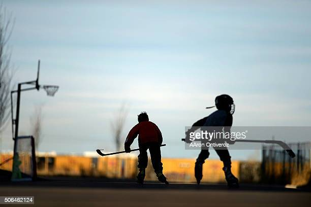 Harrison Klamser and Orin Crady play street hockey in their Stapletonarea neighborhood as the sun fades late in the day Temperatures in Denver...
