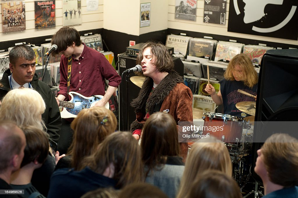 Harrison Koisser, Sam Koisser and Dominic Boyce of Peace perform during an instore gig at Head Records to promote the release of their debut album 'In Love' on March 29, 2013 in Leamington Spa, England.