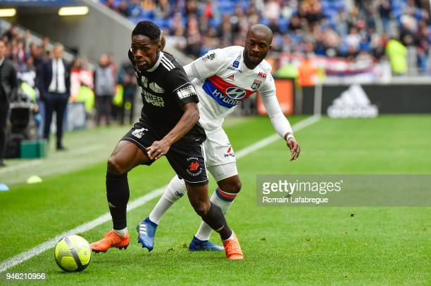 Harrison Manzala of Amiens and Tanguy Ndombele Alvaro of Lyon during the Ligue 1 match between Lyon and Amiens at Parc Olympique on April 14 2018 in...