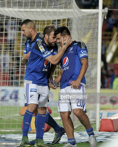 Harrison Otalvaro of Millonarios celebrates with Federico Insua after scoring the winning goal during a match between Millonarios and Deportes Tolima...