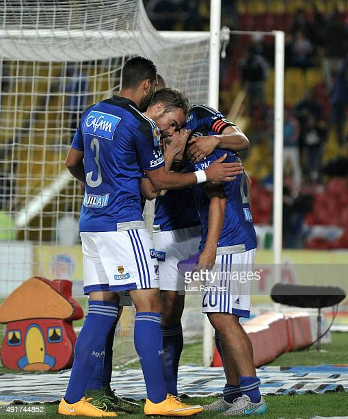 Harrison Otálvaro of Millonarios celebrates with his teammates after scoring the winning goal during a match between Millonarios and Deportes Tolima...