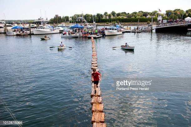 Harrison Page of South Brewer races in the International Great Lobster Crate Race at the Maine Lobster Festival in Rockland on Sunday August 5 2018