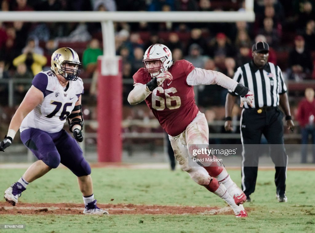 Harrison Phillips #66 of the Stanford Cardinal plays in an NCAA Pac-12 football game against the University of Washington Huskies on November 10, 2017 at Stanford Stadium in Palo Alto, California. At left is Luke Wattenberg #76 of Washington.