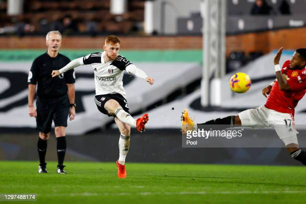 Harrison Reed of Fulham shoots under pressure from Fred of Manchester United during the Premier League match between Fulham and Manchester United at...