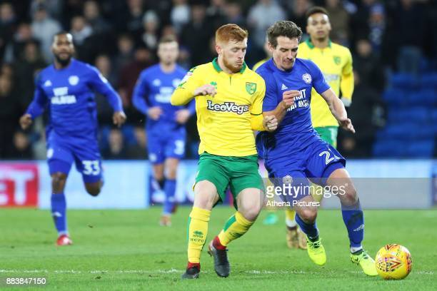 Harrison Reed of Norwich City challenges Craig Bryson of Cardiff City during the Sky Bet Championship match between Cardiff City and Norwich City at...