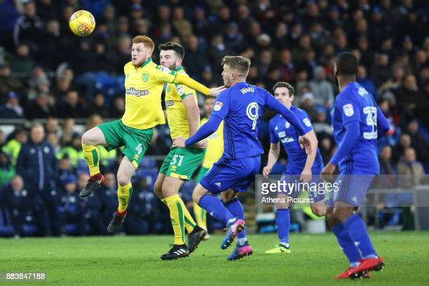 Harrison Reed of Norwich City is challenged by Danny Ward of Cardiff City during the Sky Bet Championship match between Cardiff City and Norwich City...