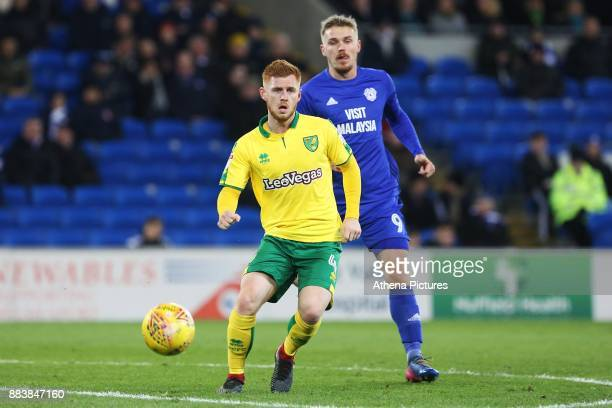 Harrison Reed of Norwich City is marked by Sean Morrison of Cardiff City during the Sky Bet Championship match between Cardiff City and Norwich City...