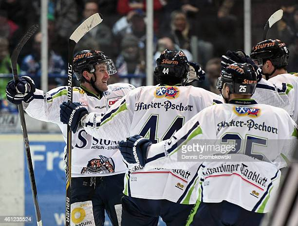 Harrison Reed of Straubing Tigers celebrates with team mates as he scores the third goal during the DEL Ice Hockey game between Iserlohn Roosters and...