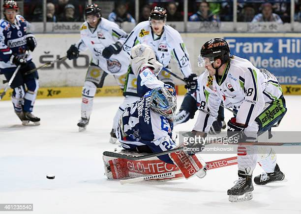 Harrison Reed of Straubing Tigers scores the third goal past goalkeeper Mathias Lange of Iserlohn Roosters during the DEL Ice Hockey game between...