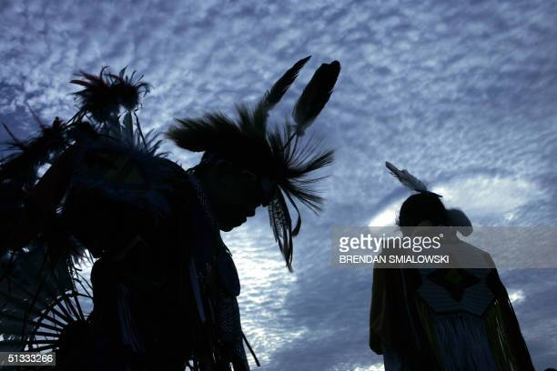 Harrison Revels and his cousin Courtney Baxter members of the Lumbee Tribe in North Carolina wait for a tribal dance on the National Mall after the...