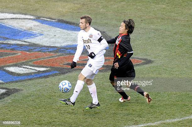 Harrison Shipp of the Notre Dame Fighting Irish handles the ball against Tsubasa Endoh of the Maryland Terrapins during the 2013 NCAA Men's College...