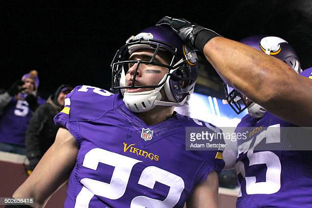 Harrison Smith and Anthony Barr of the Minnesota Vikings celebrate Smith's interception for a touchdown in the second quarter against the New York...
