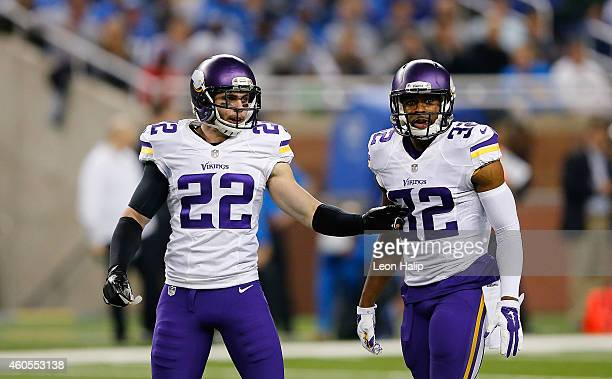 Harrison Smith and Antone Exum Jr #32 of the Minnesota Vikings look to the sidelines during the second quarter of the game against the Detrout Lions...