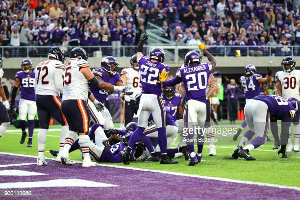 Harrison Smith and Mackensie Alexander of the Minnesota Vikings signal fourth down after holding the Chicago Bears on the goal line in the fourth...